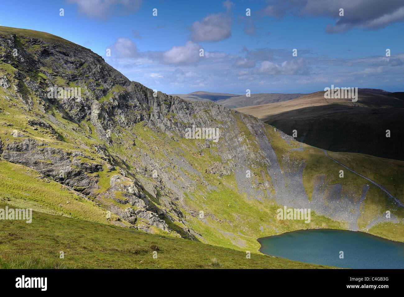 Sharp Edge on Blencathra, with Scales Tarn below. - Stock Image