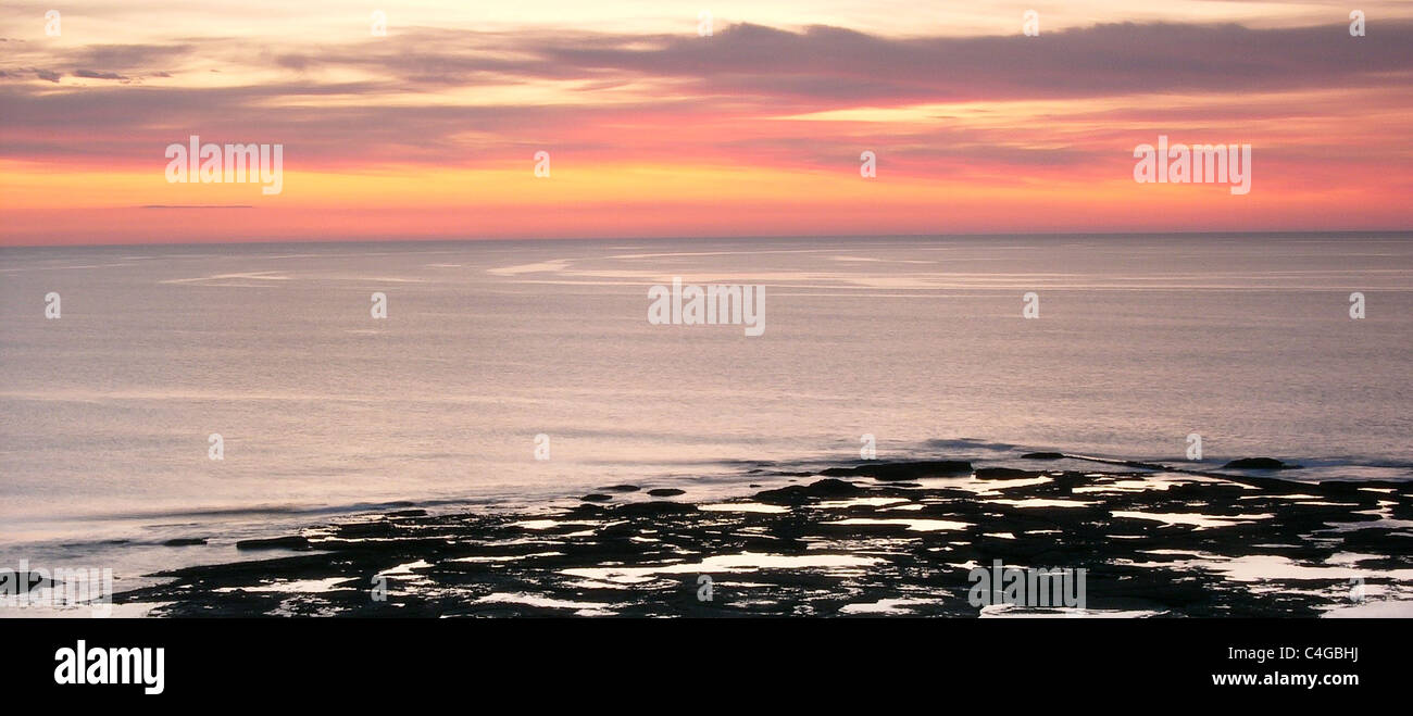 Dawn over  a calm sea in the North East of England - Stock Image