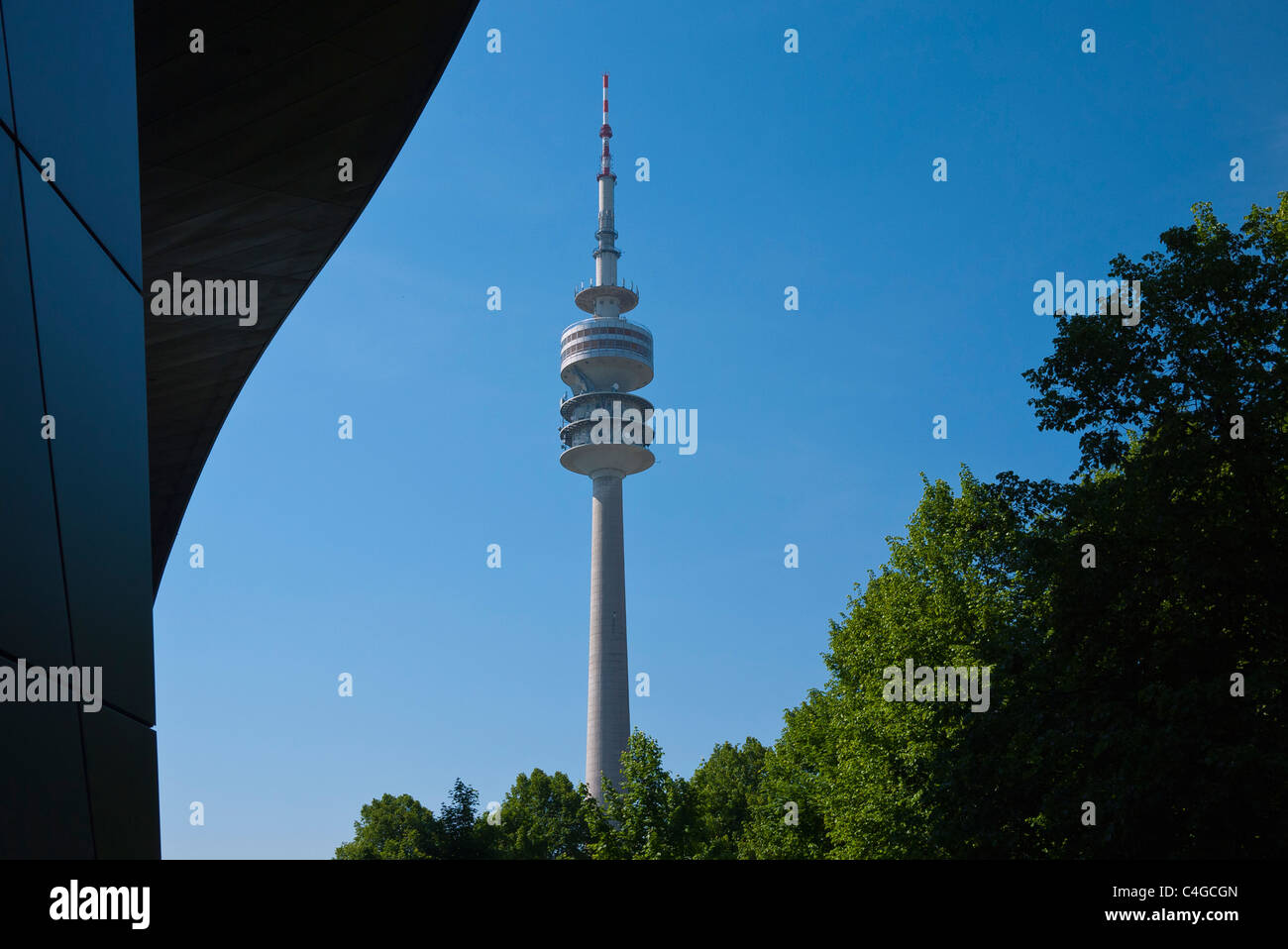 A detail of the Olympic Tower, Olympiaturm, and a portion of the BWM World (Welt) building in Munich, Germany. - Stock Image