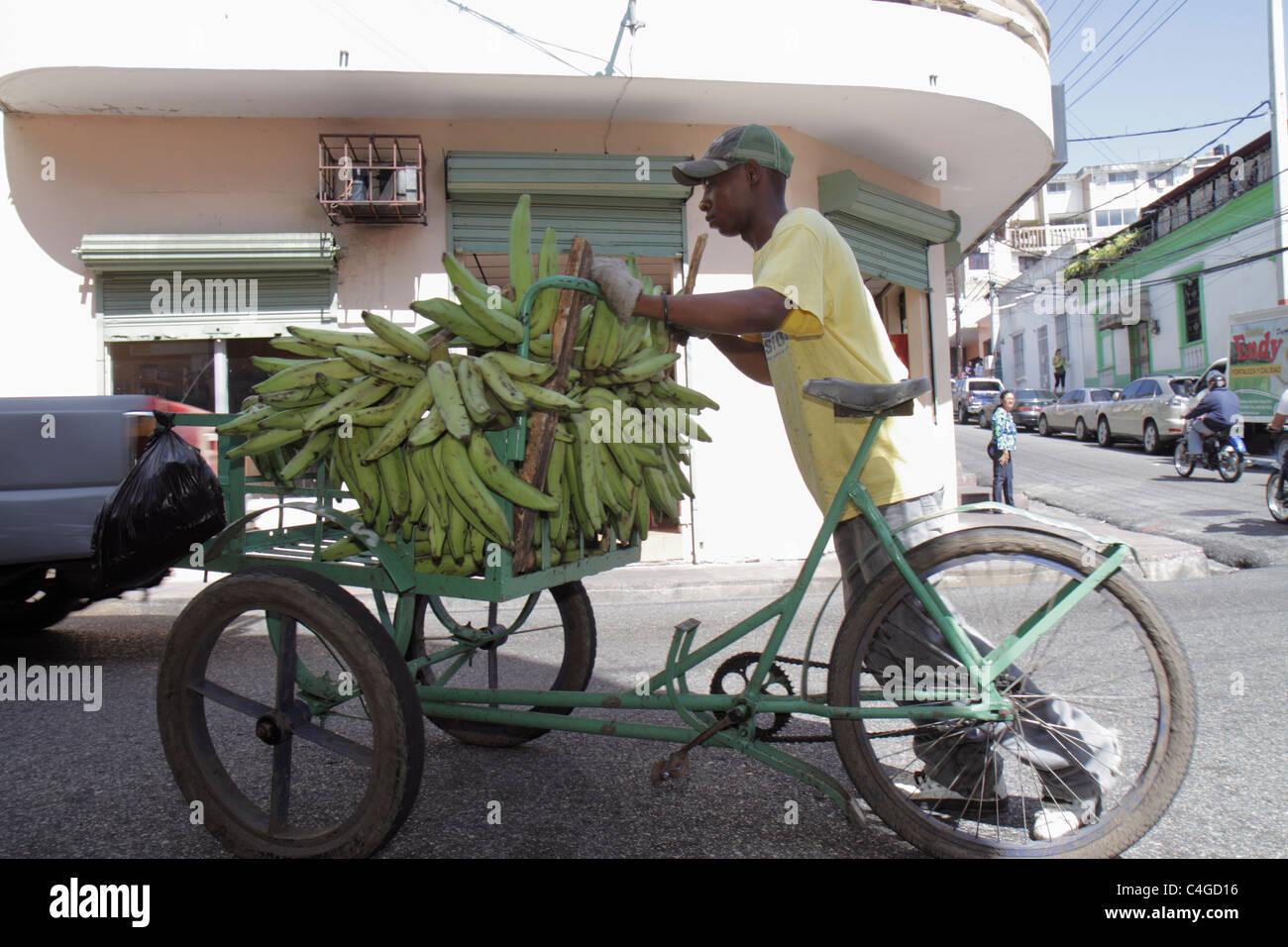 Santo Domingo Dominican Republic Ciudad Colonia Calle Santome Hispanic Black man street scene vendor produce green - Stock Photo