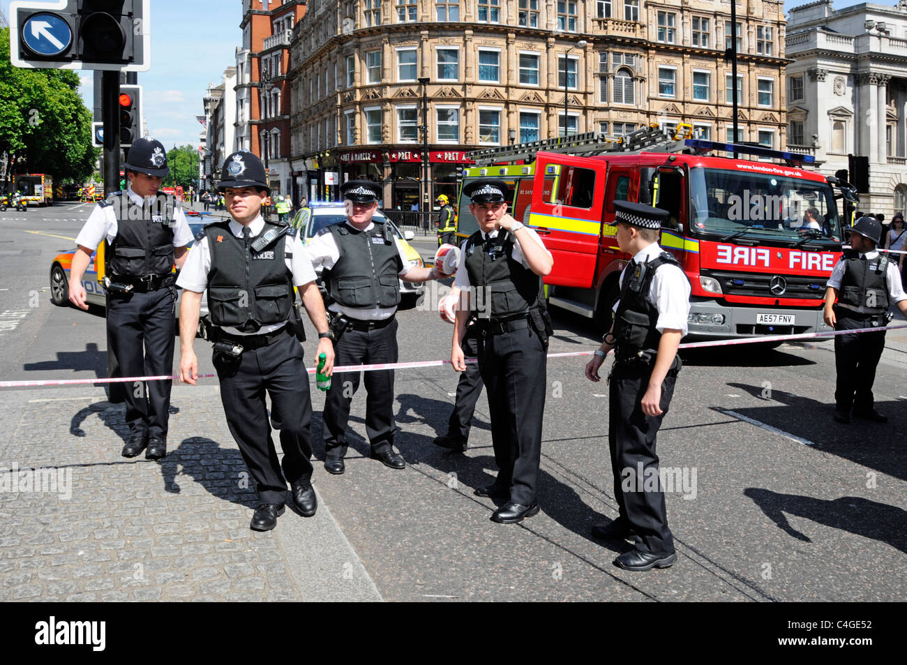Police officers about to clear public from scene of major fire at Marconi House London - Stock Image