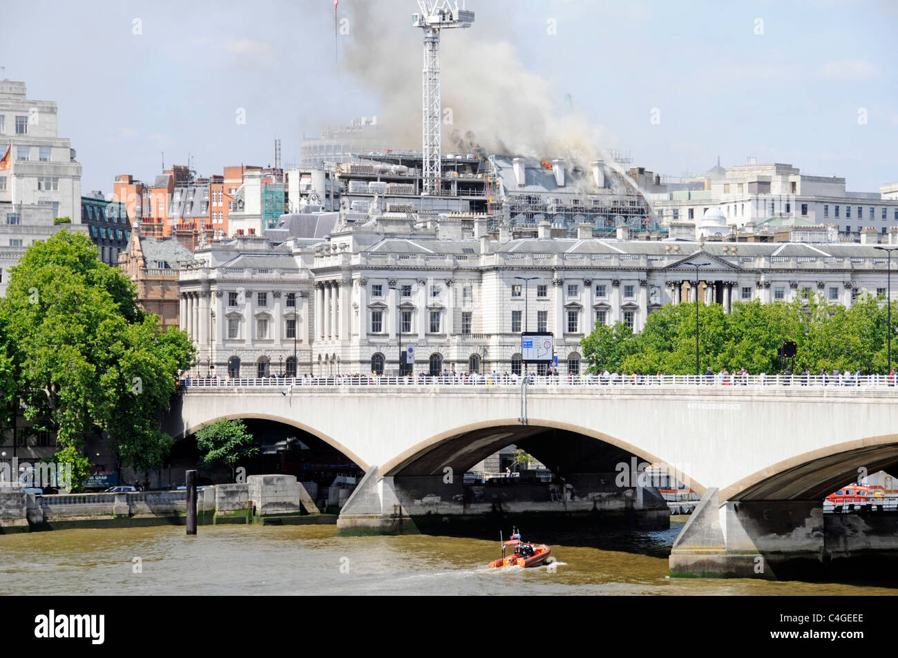 Urban London landscape skyline construction building site Marconi House roof on fire during conversion work beyond Stock Photo