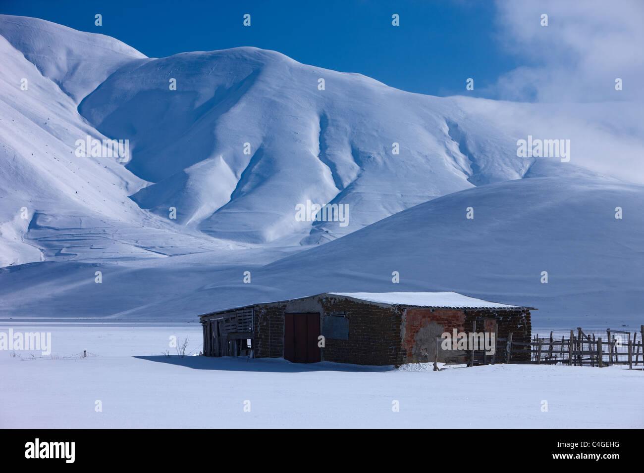 the Piano Grande in winter, Monti Sibillini National Park, Umbria, Italy Stock Photo