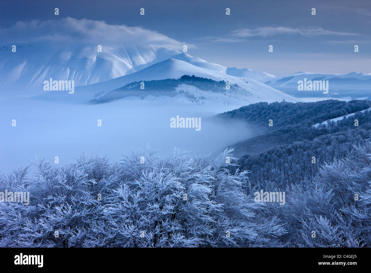 snow and ice on the Piano Grande in winter with Monte Vettore beyond, Monti Sibillini National Park, Umbria, Italy - Stock Image