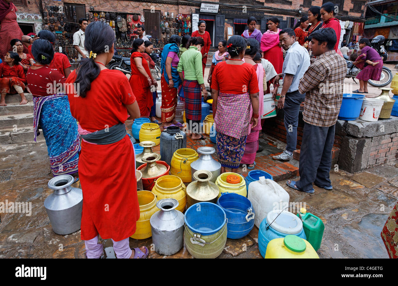 Nepal - Kathmandu Valley - Bhaktapur - women queuing for water - Stock Image
