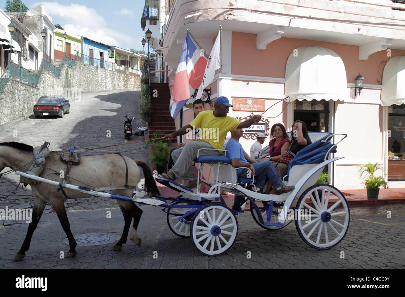 Santo Domingo Dominican Republic Ciudad Colonia Calle Hostos street scene horse carriage ride Black Hispanic man Stock Photo