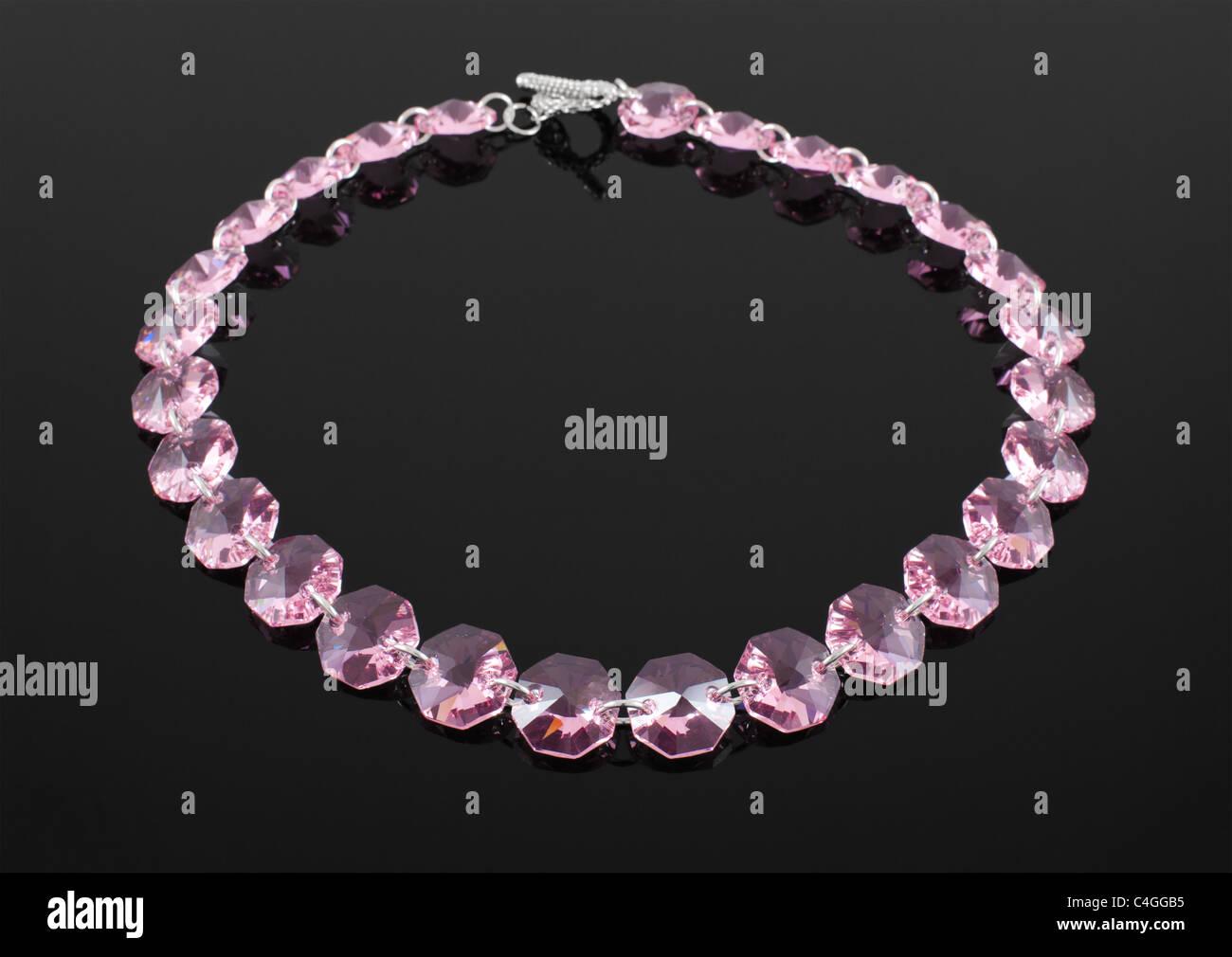 Fashion necklace on black background - Stock Image