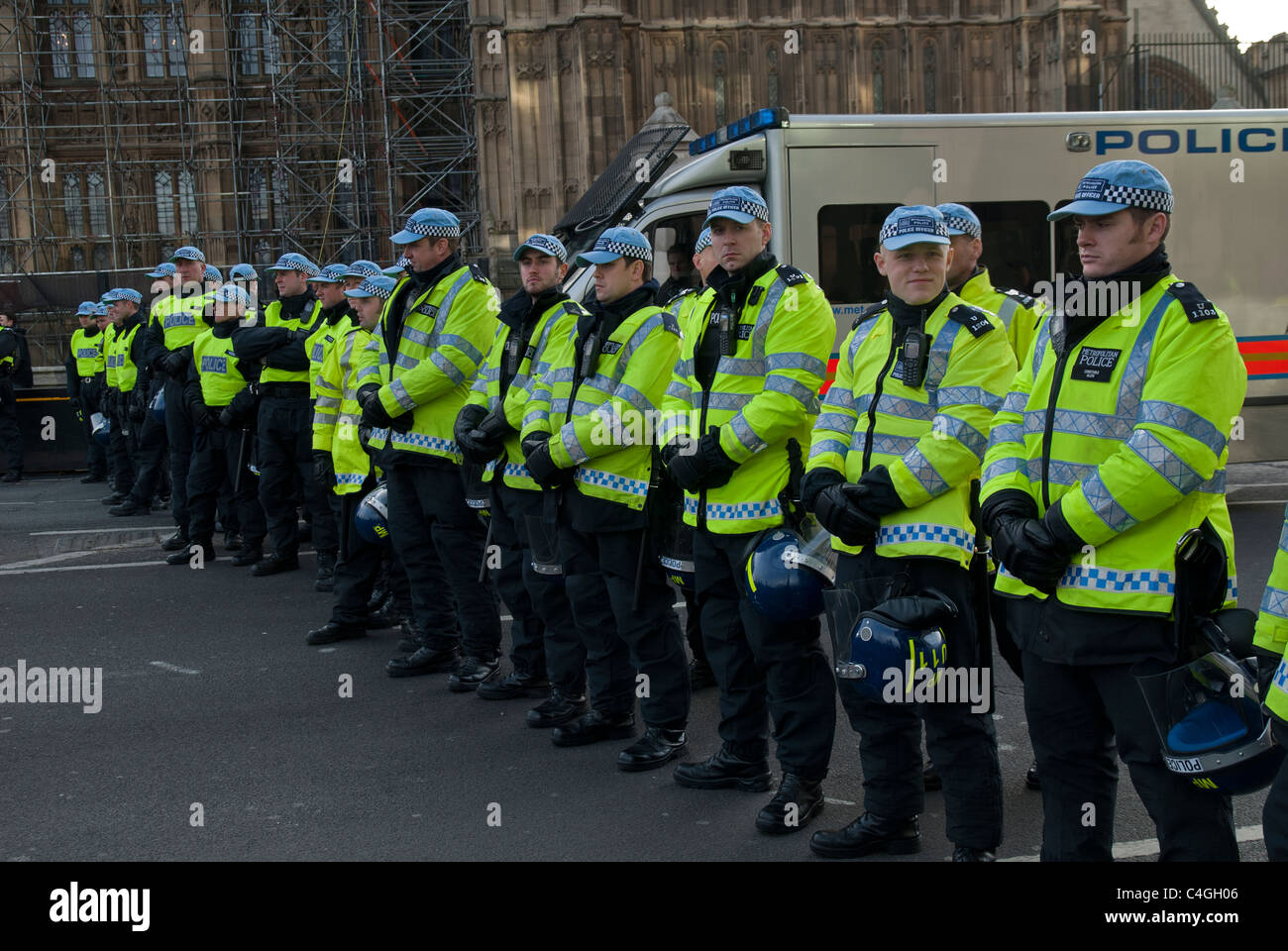 RIOT POLICE LINED UP AGAINST PROTESTERS - Stock Image