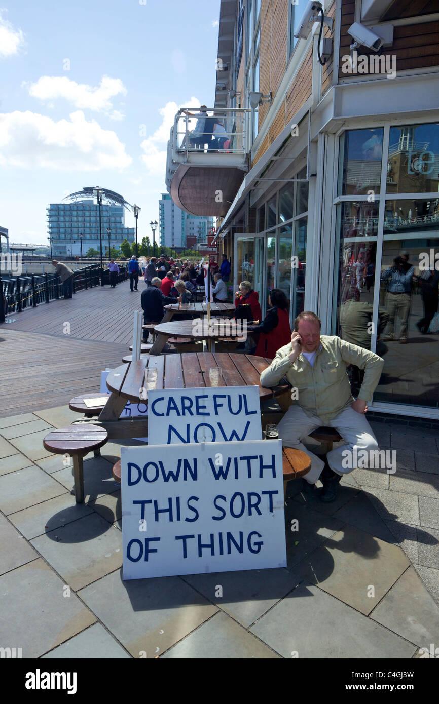 Polite protestor, Mermaid Quay, Cardiff Bay, South Glamorgan, Wales, cymru, UK, United Kingdom, GB, Great Britain, - Stock Image