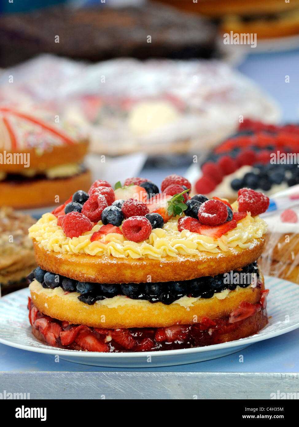 A large fruit cake at an old fashioned tea party. - Stock Image