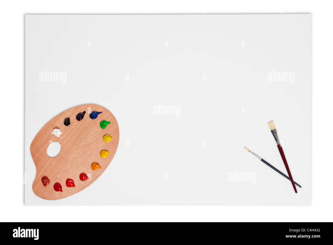 Photo of an artists blank canvas with brushes and paint palette isolated on a white background with clipping path. - Stock Image