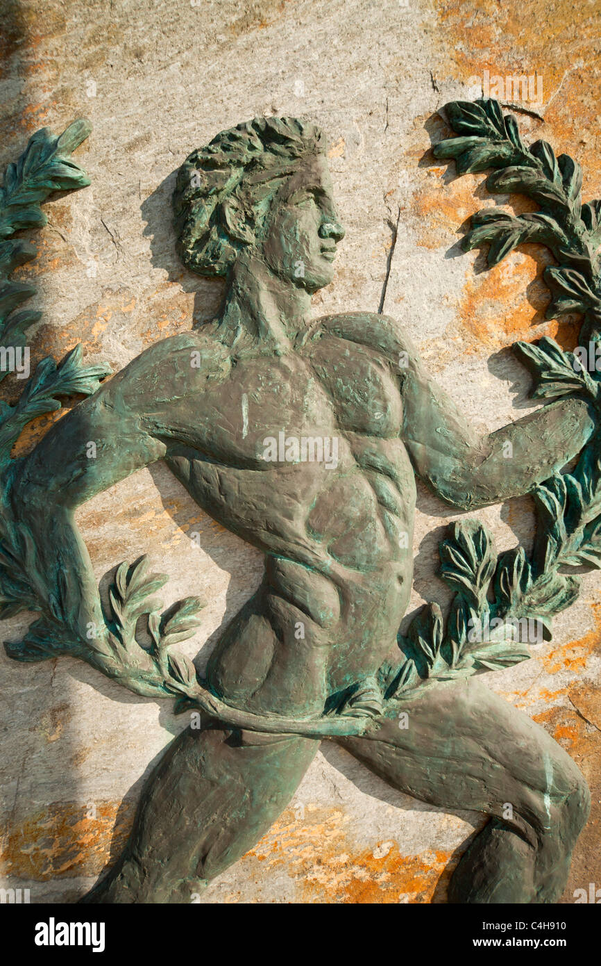 relief with ancient greek sportsman at the small village Agnontas, Skopelos Island, Northern Sporades, Greece - Stock Image
