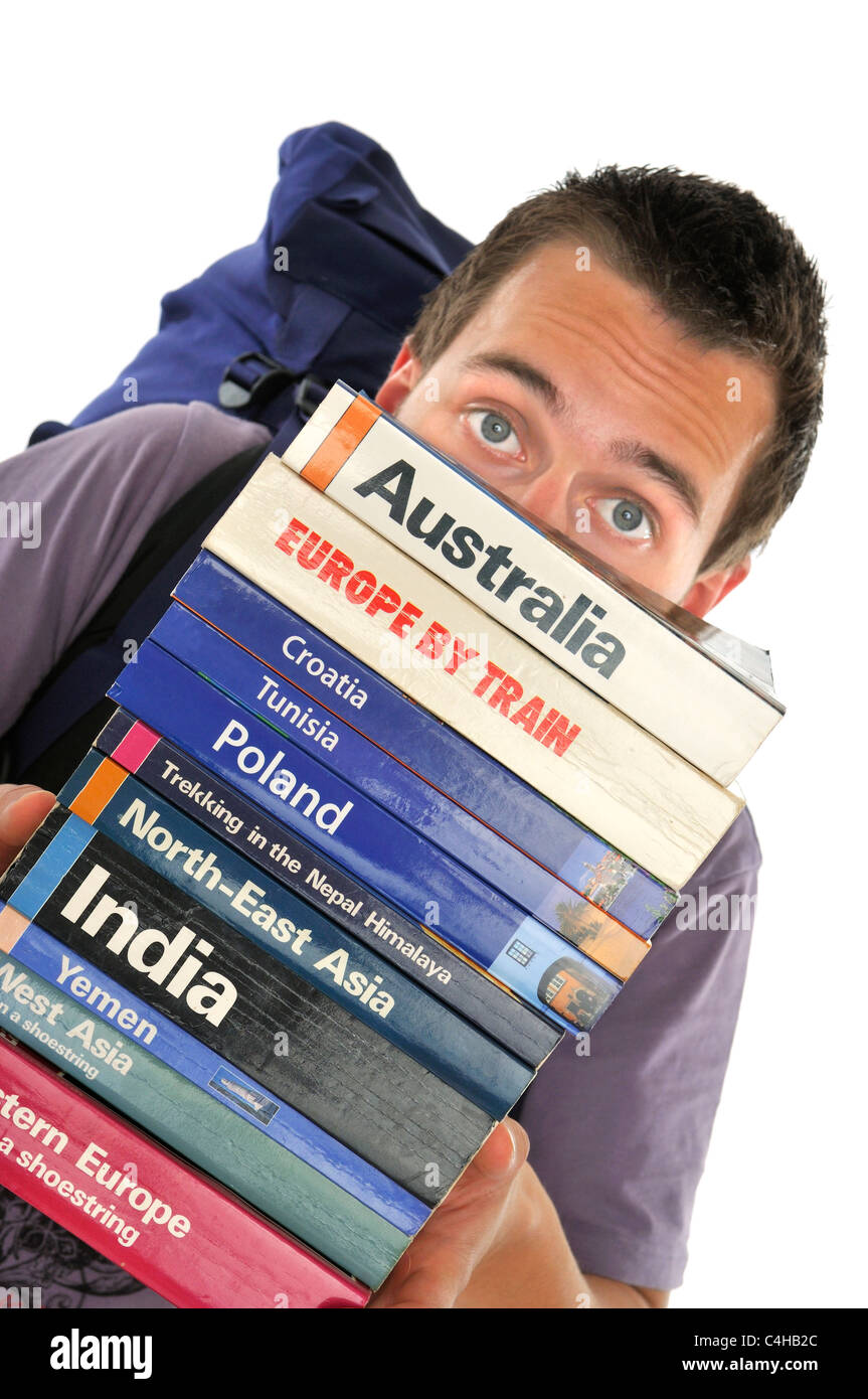 young male backpacker with travel guides - Stock Image