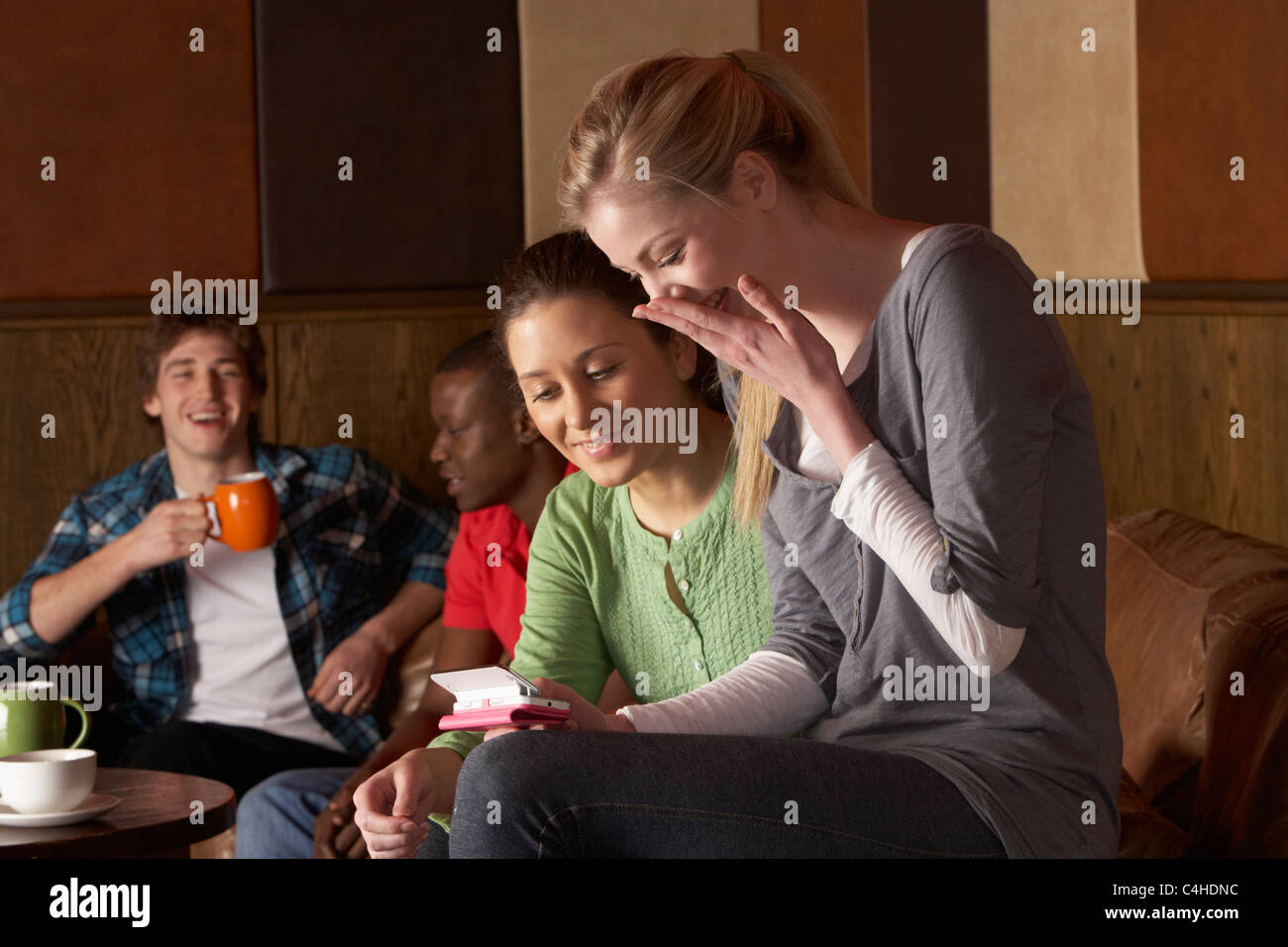 Young friends in café Stock Photo