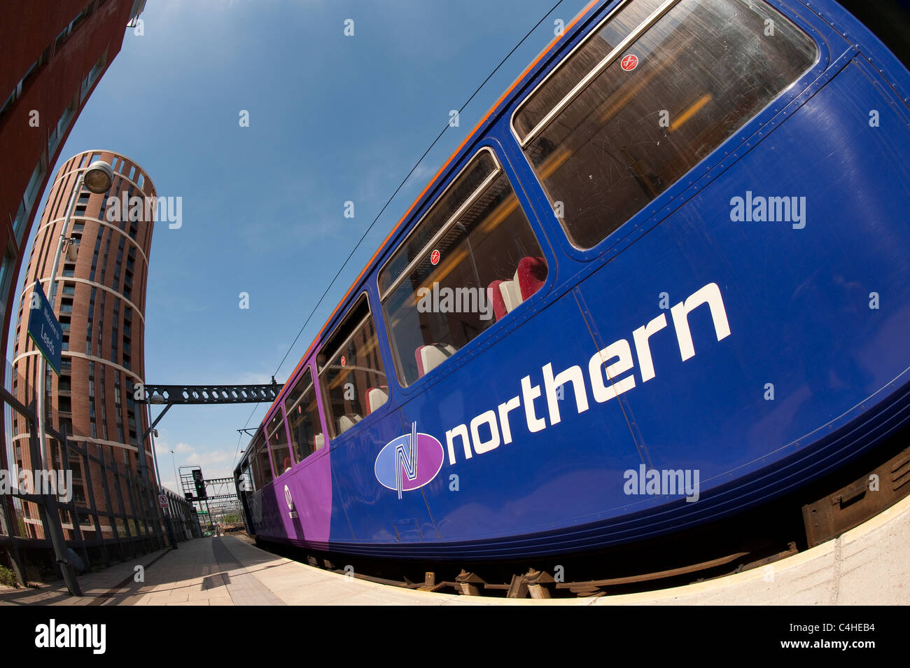 Class 144 pacer train in Northern Rail livery at a railway station in England. - Stock Image