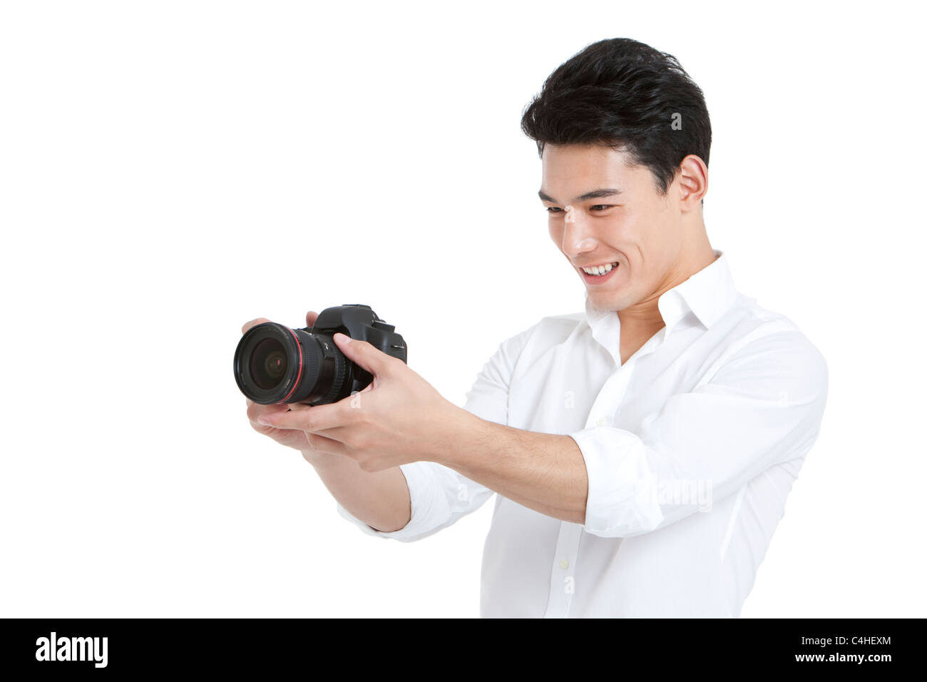 Young man taking photos - Stock Image