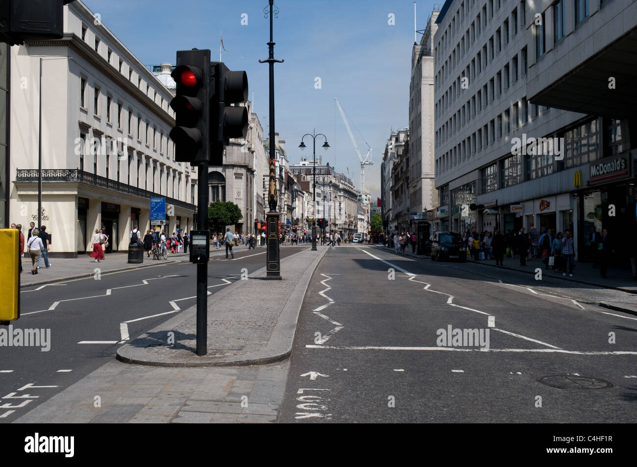 Lunchtime on a Tuesday and the Strand has no traffic due to a fire in Marconi House in the Aldwych London - Stock Image