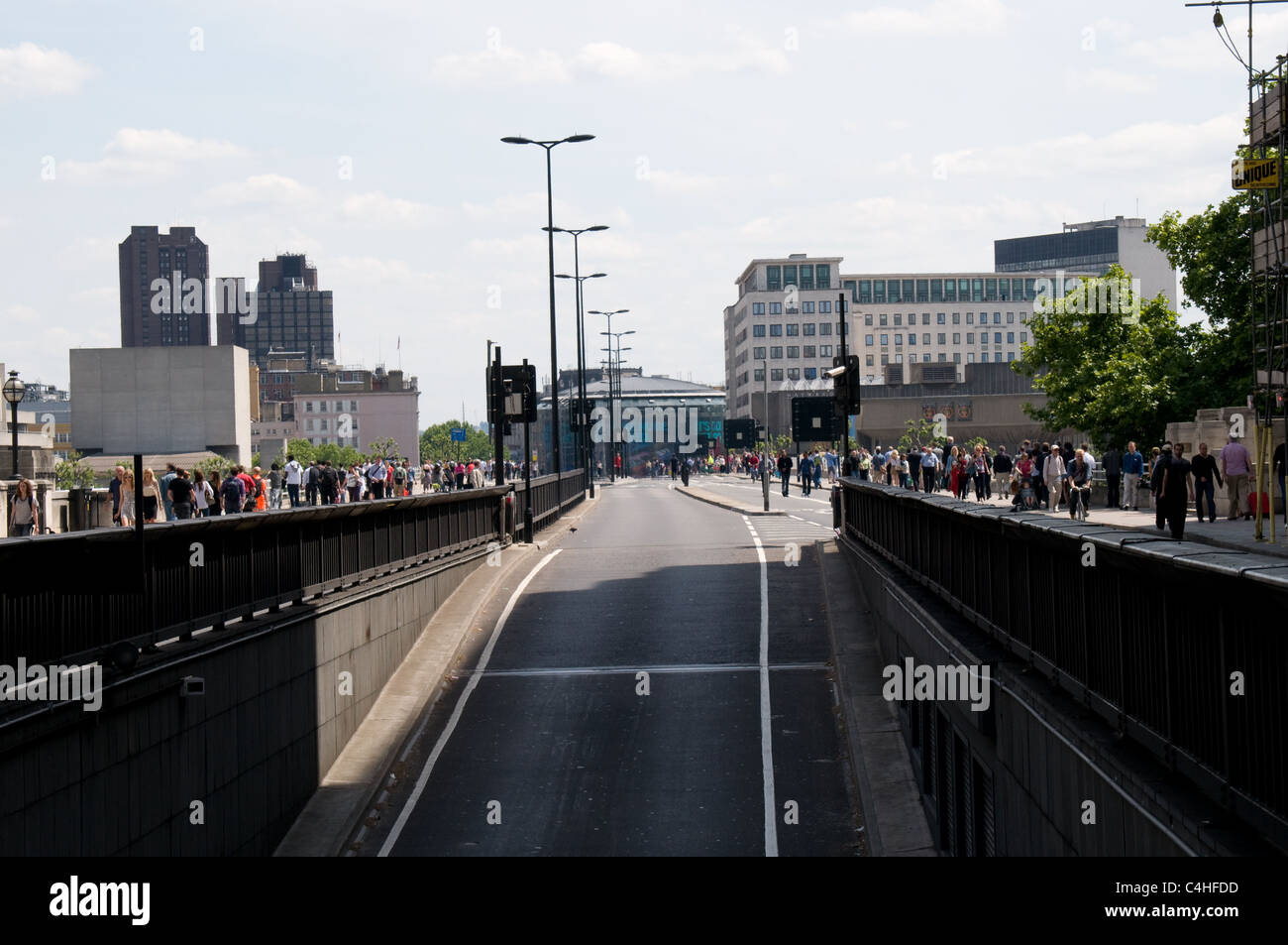 Lunchtime on a Tuesday and Waterloo Bridge has no traffic due to a fire in Marconi House in the Aldwych London - Stock Image