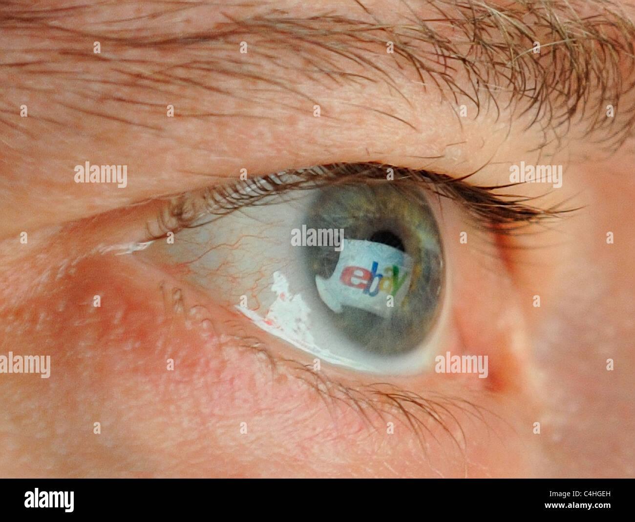 Company Logo mirrored in Eye - Stock Image