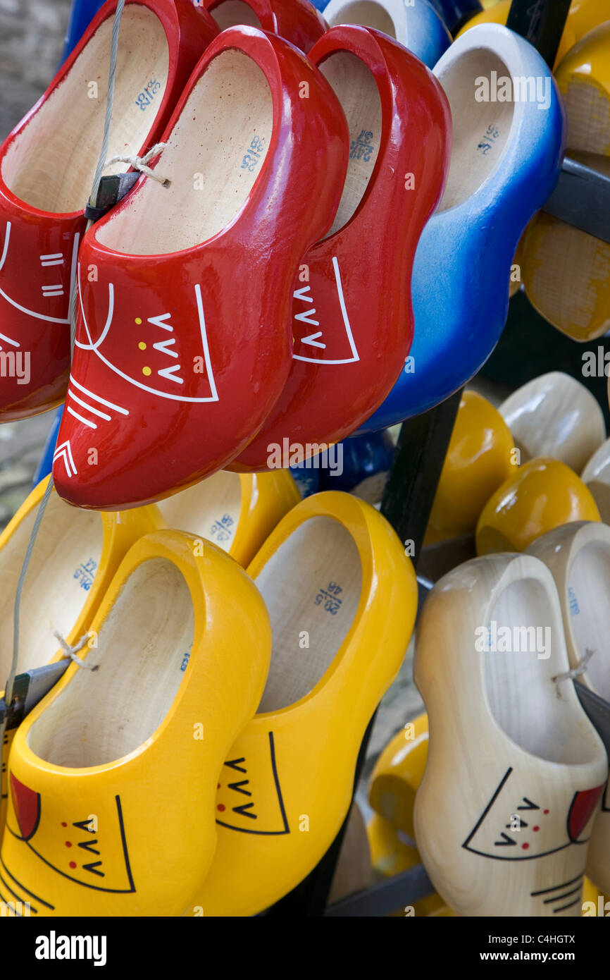 Colorful wooden Dutch clogs on display in souvenir shop, the Netherlands - Stock Image