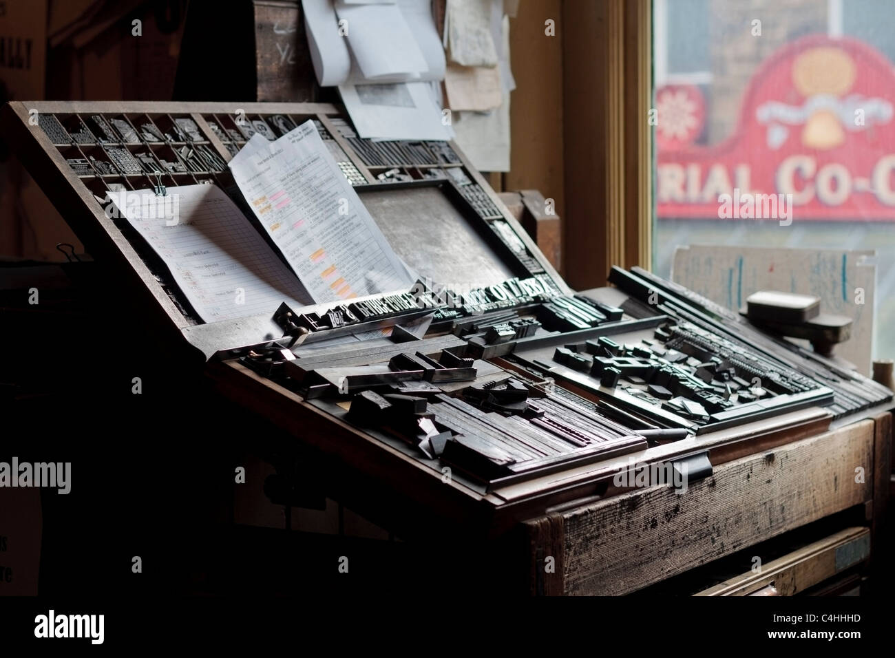 Old fashioned compositors table with metal letters at the printshop in Beamish museum Durham England - Stock Image