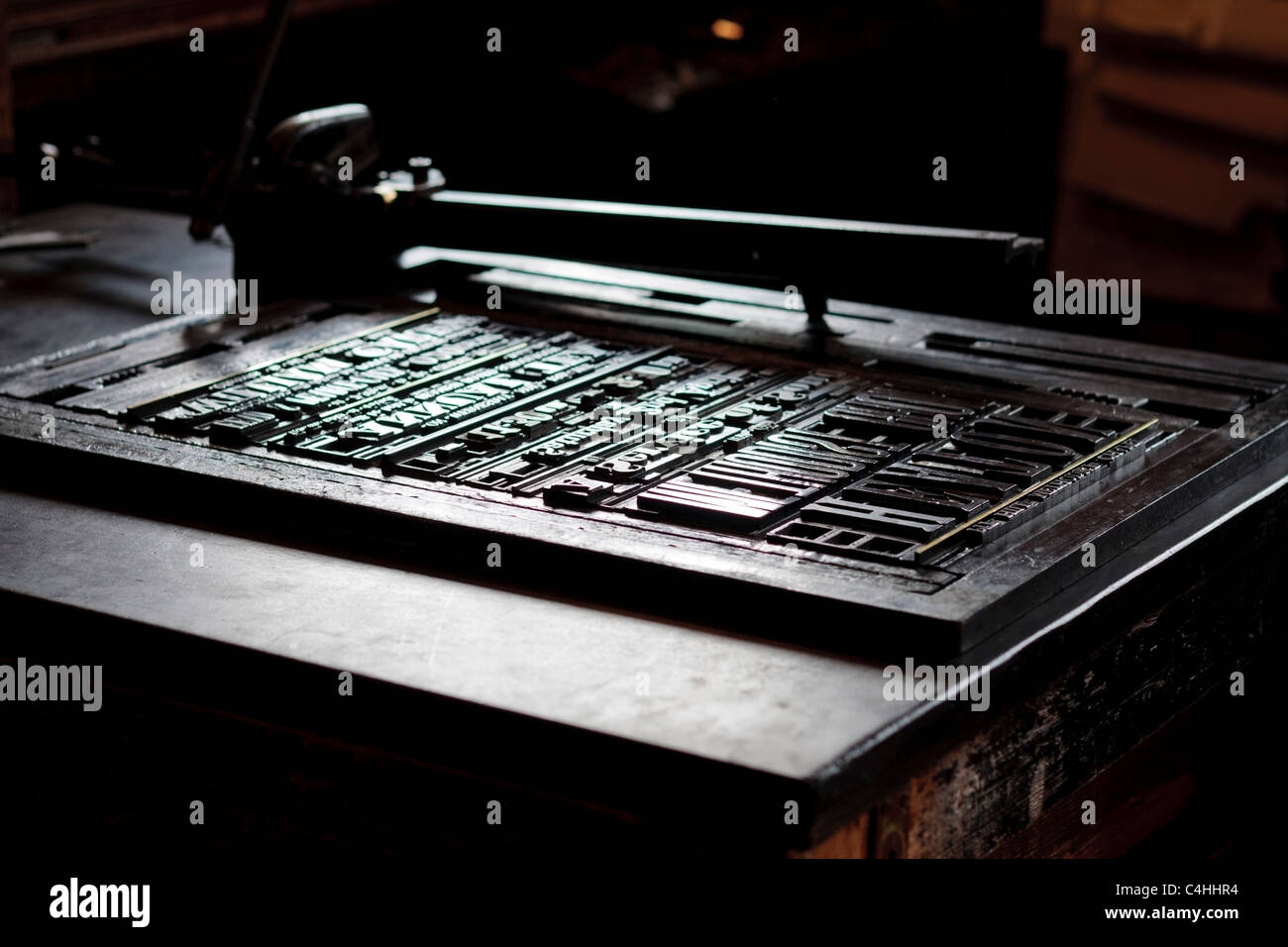 Old fashioned layout table with metal letters at the printshop in Beamish museum Durham England - Stock Image
