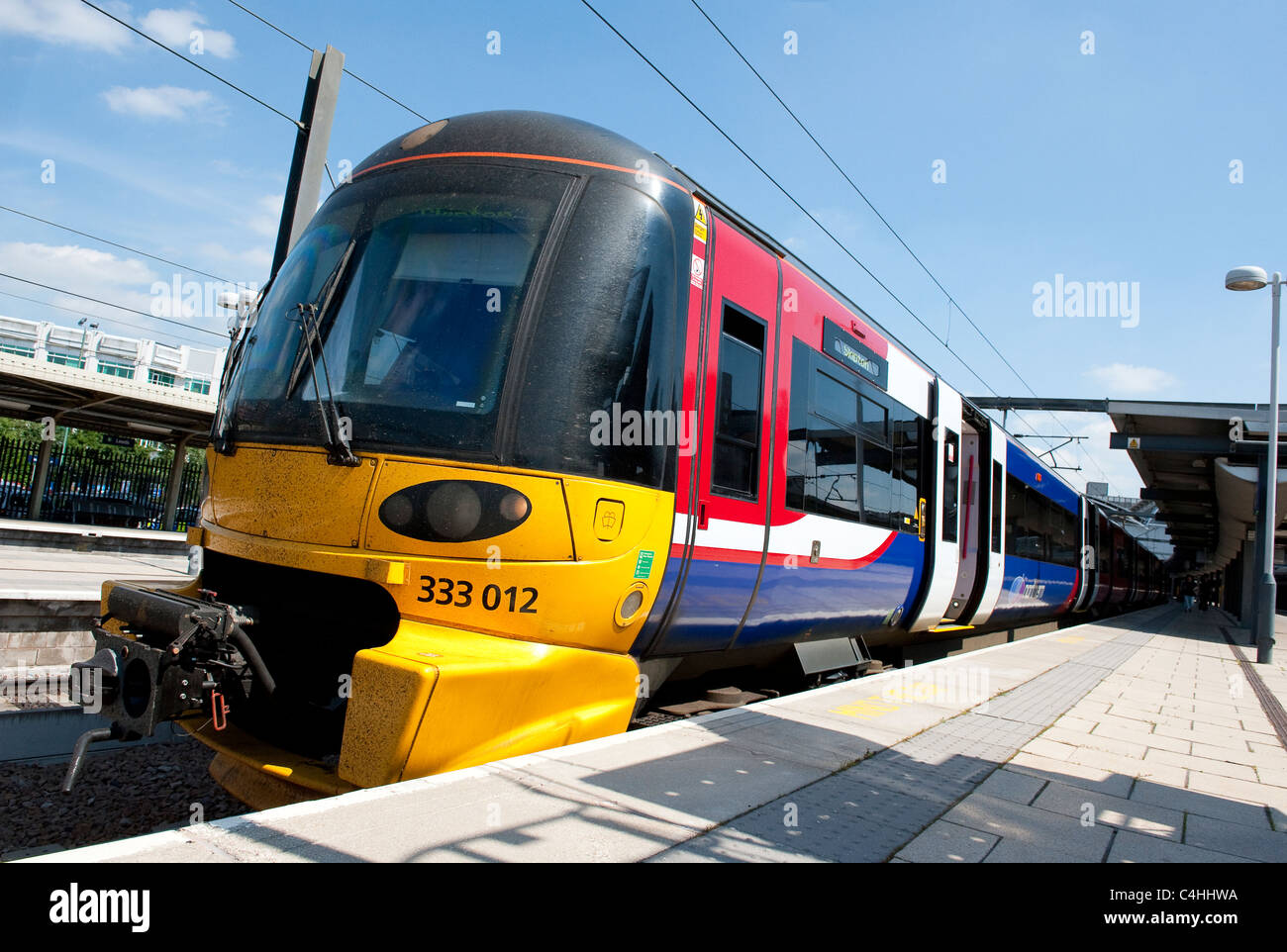 Class 333 train in Northern Rail livery at Leeds railway station in England. - Stock Image
