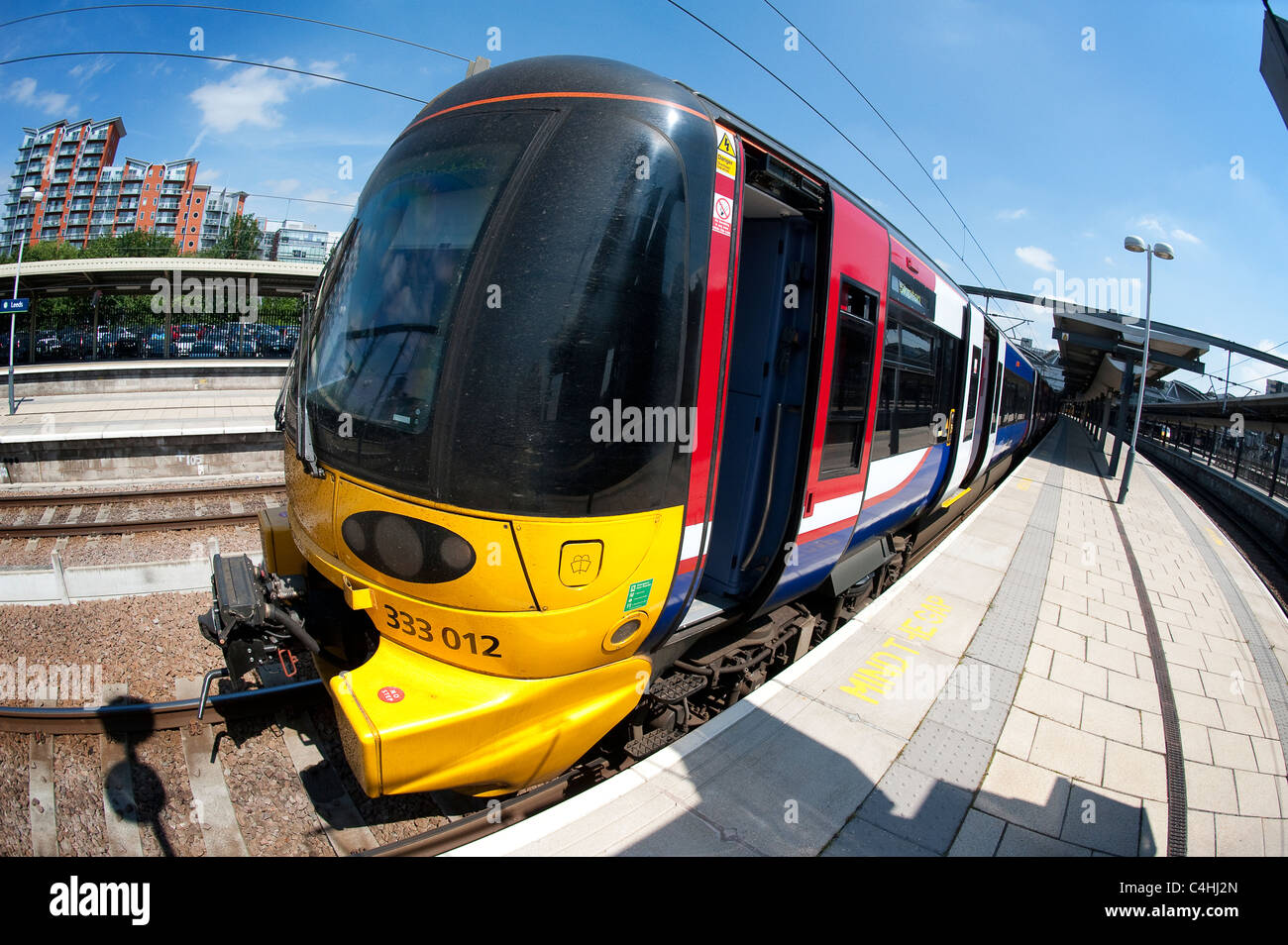 Class 333 train in Northern Rail livery at a railway station in England. - Stock Image
