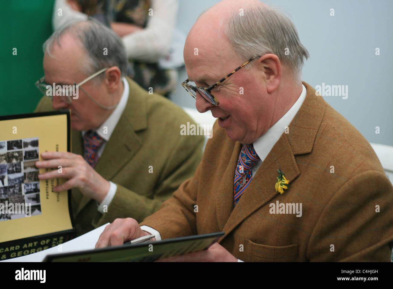 Gilbert and George, iconic East End London artists since the 1960s, sign their books at the Hay Literary Festival, - Stock Image