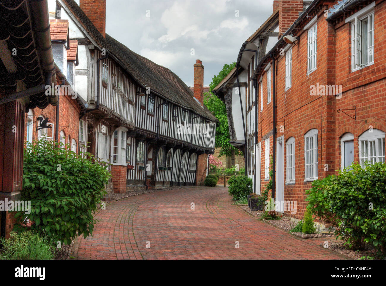 Half timbered cottages in Malt Mill Lane, Alcester, UK - Stock Image