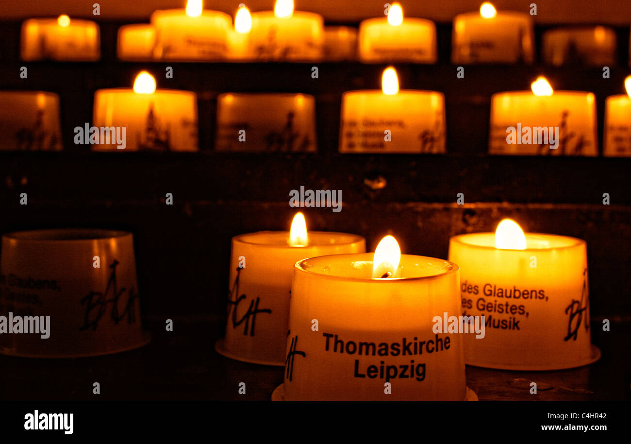 Memorial candlelights inside the Thomas church in Leipzig, Germany - Stock Image