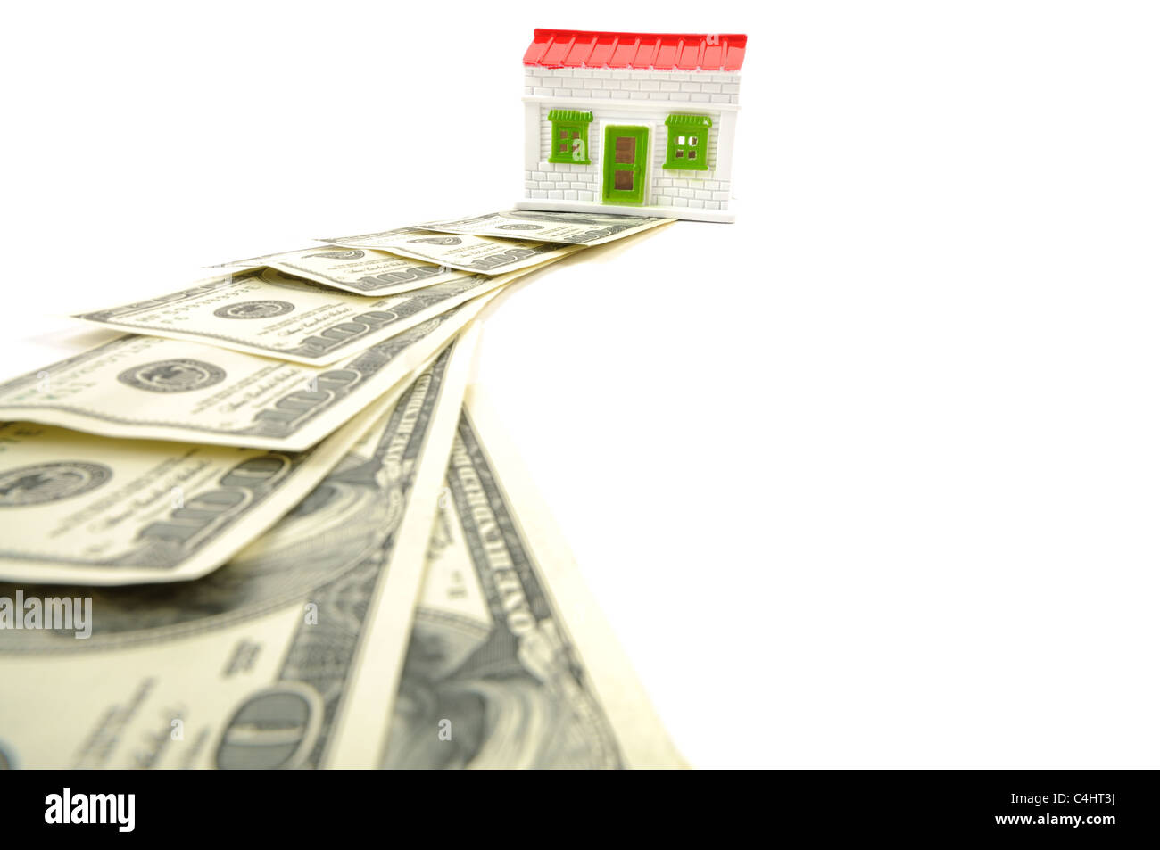 A way to get a new house, dollars and house over white background - Stock Image