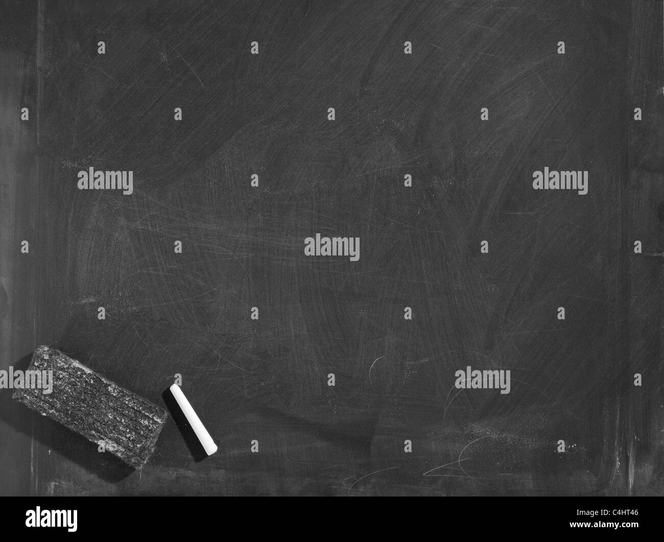 Blackboard with chalk and eraser - Stock Image