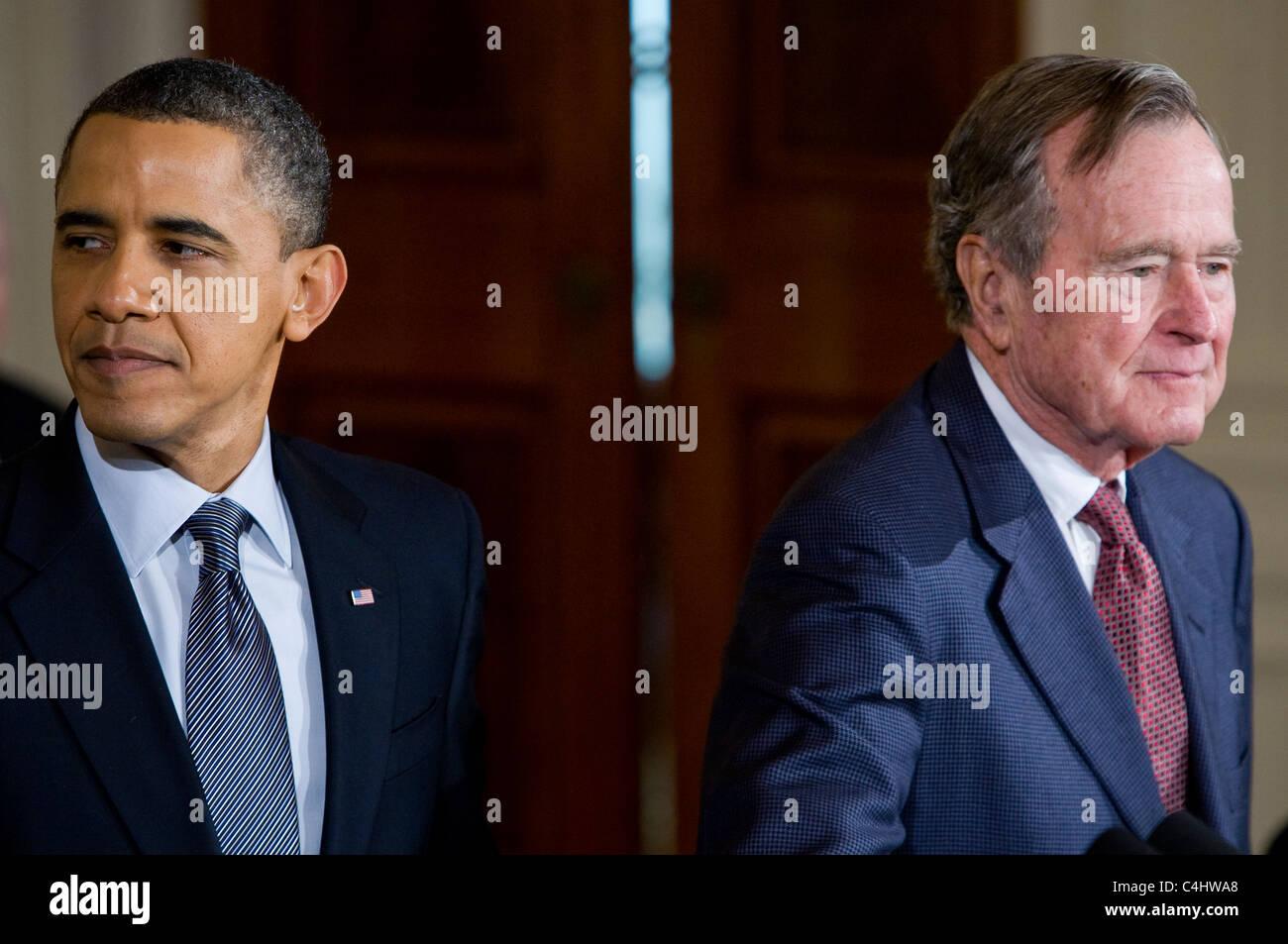 President Barack Obama presents the Presidential Medal of Freedom to former President George H.W. Bush. - Stock Image