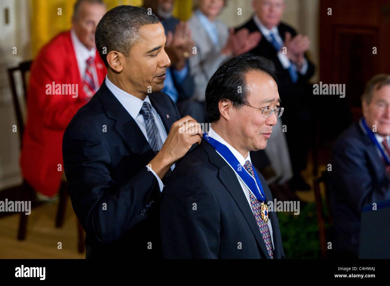 President Barack Obama presents the Presidential Medal of Freedom to Yo-Yo Ma. Stock Photo