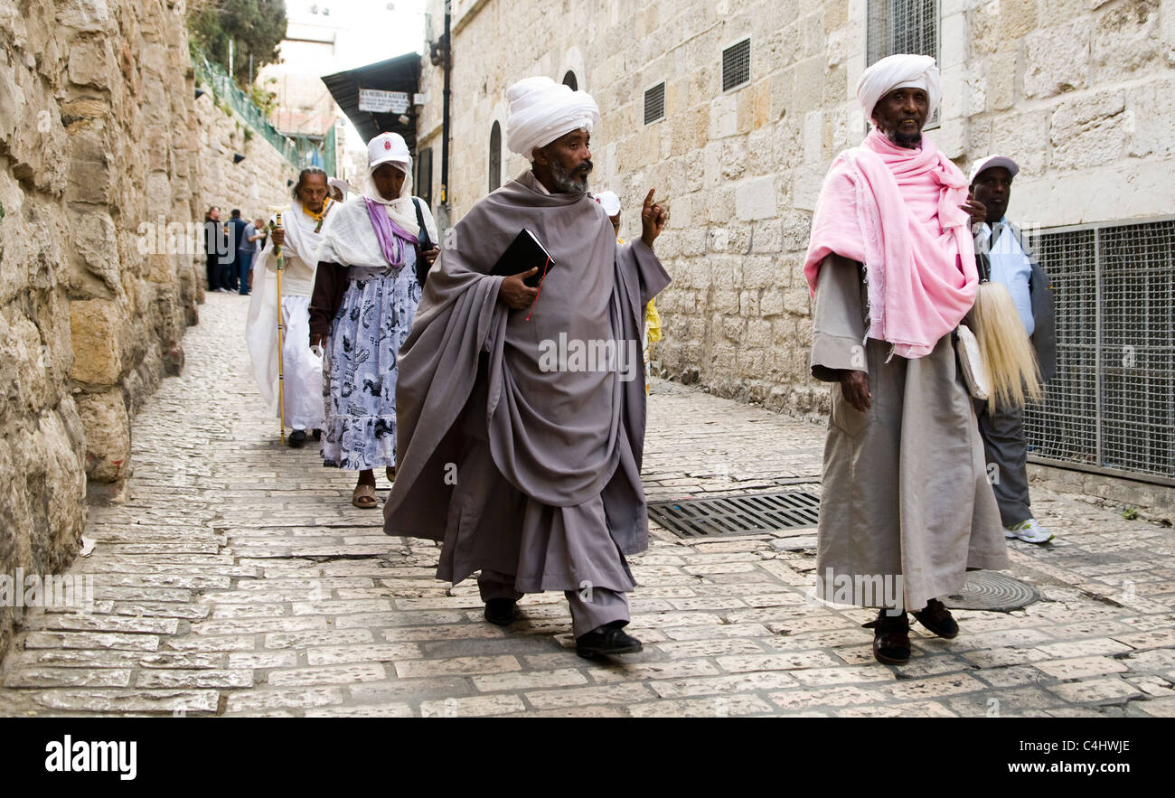 Good Friday procession in the Via Dolorosa in the old city of Jerusalem. - Stock Image
