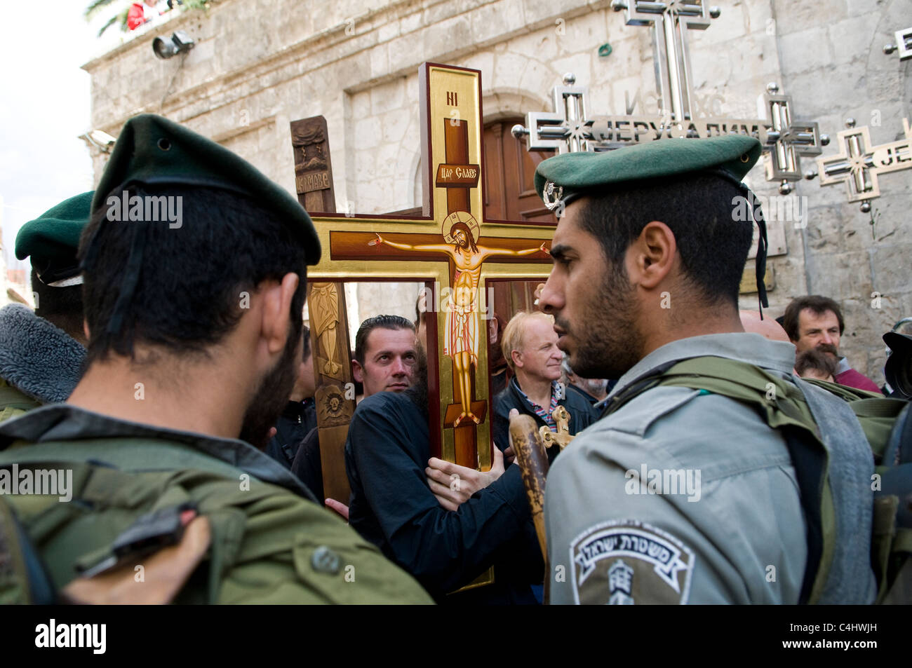 Israeli border police secure the 'Good Friday' procession in the Via Dolorosa in the old city of Jerusalem. - Stock Image