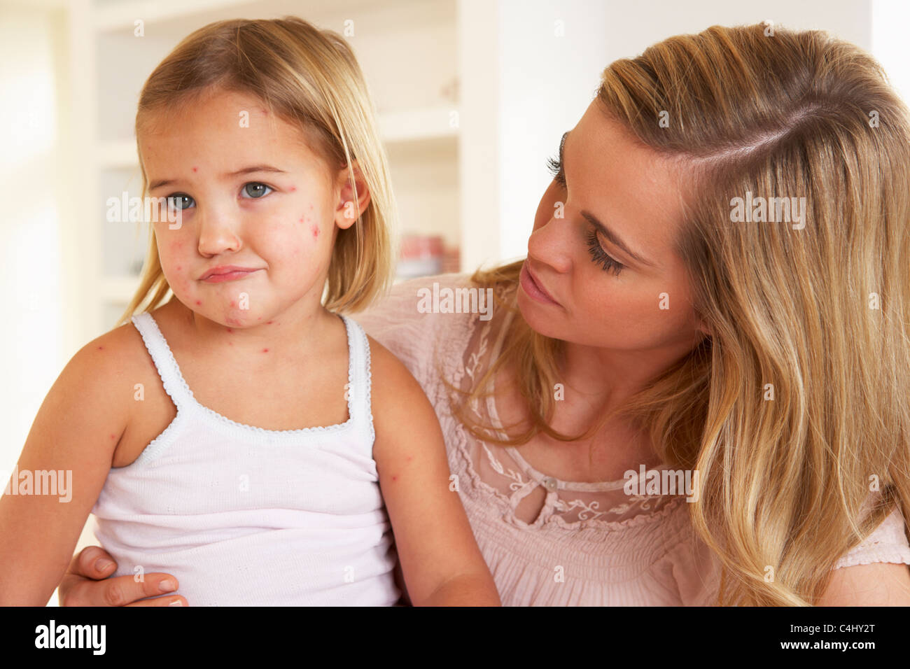 Mother nursing sick child - Stock Image