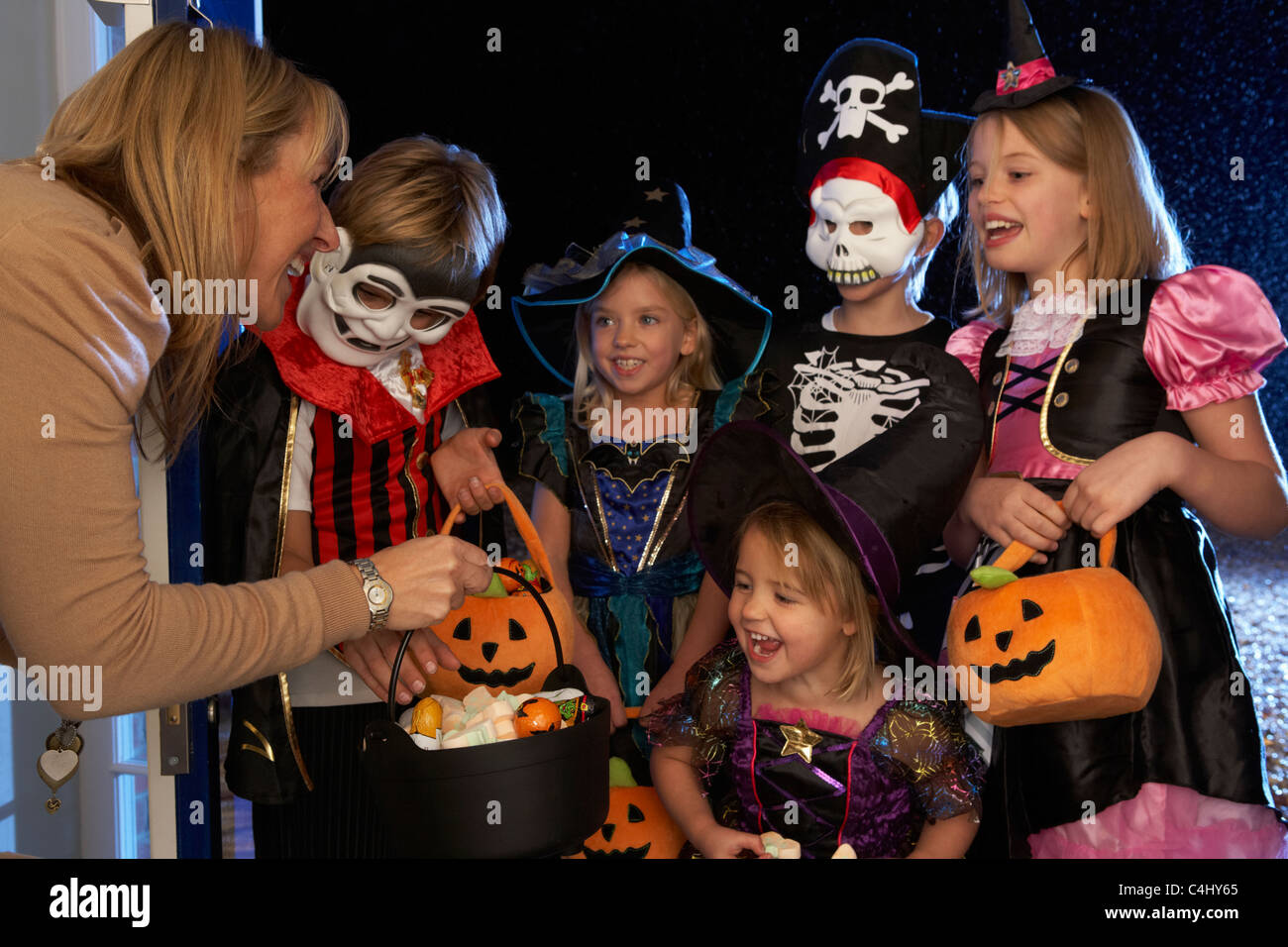 Happy Halloween party with children trick or treating - Stock Image