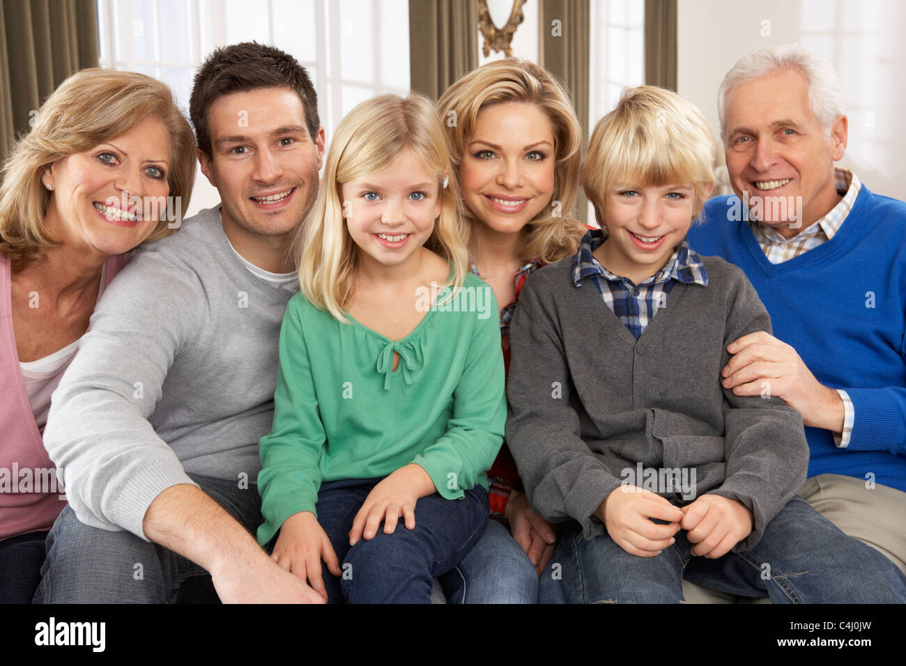 Portrait Of Three Generation Family At Home - Stock Image