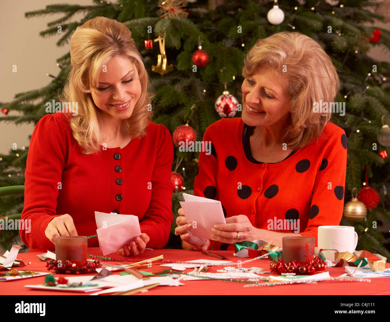 Women Making Christmas Cards At Home - Stock Image