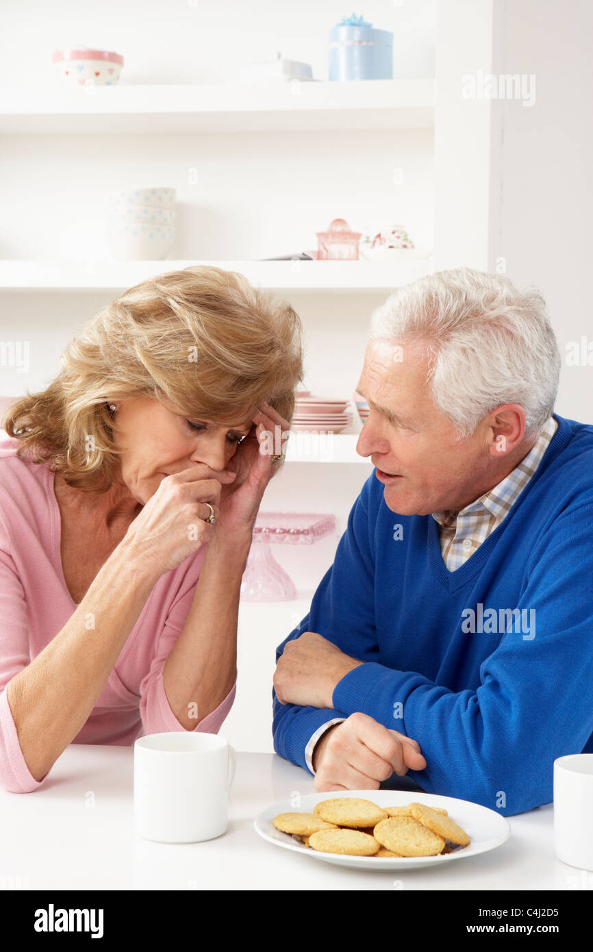 Senior Man Consoling Wife - Stock Image