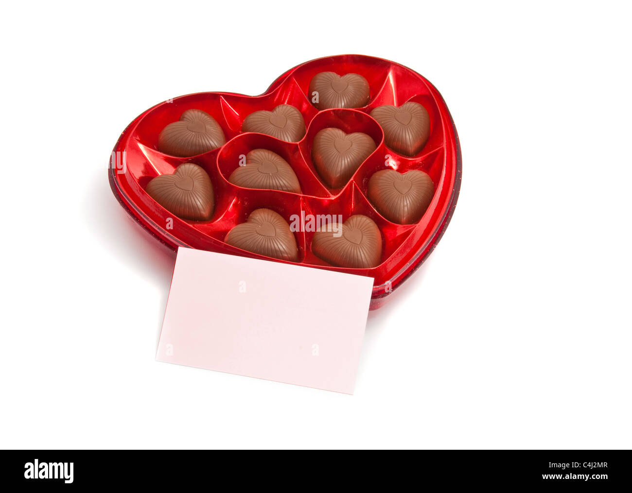 chocolate heart shape on white background with message card - Stock Image