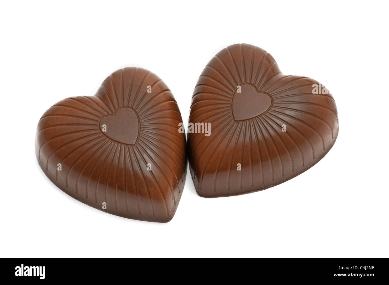 Pair oftop view of chocolate heart shaped candies isolated on white - Stock Image