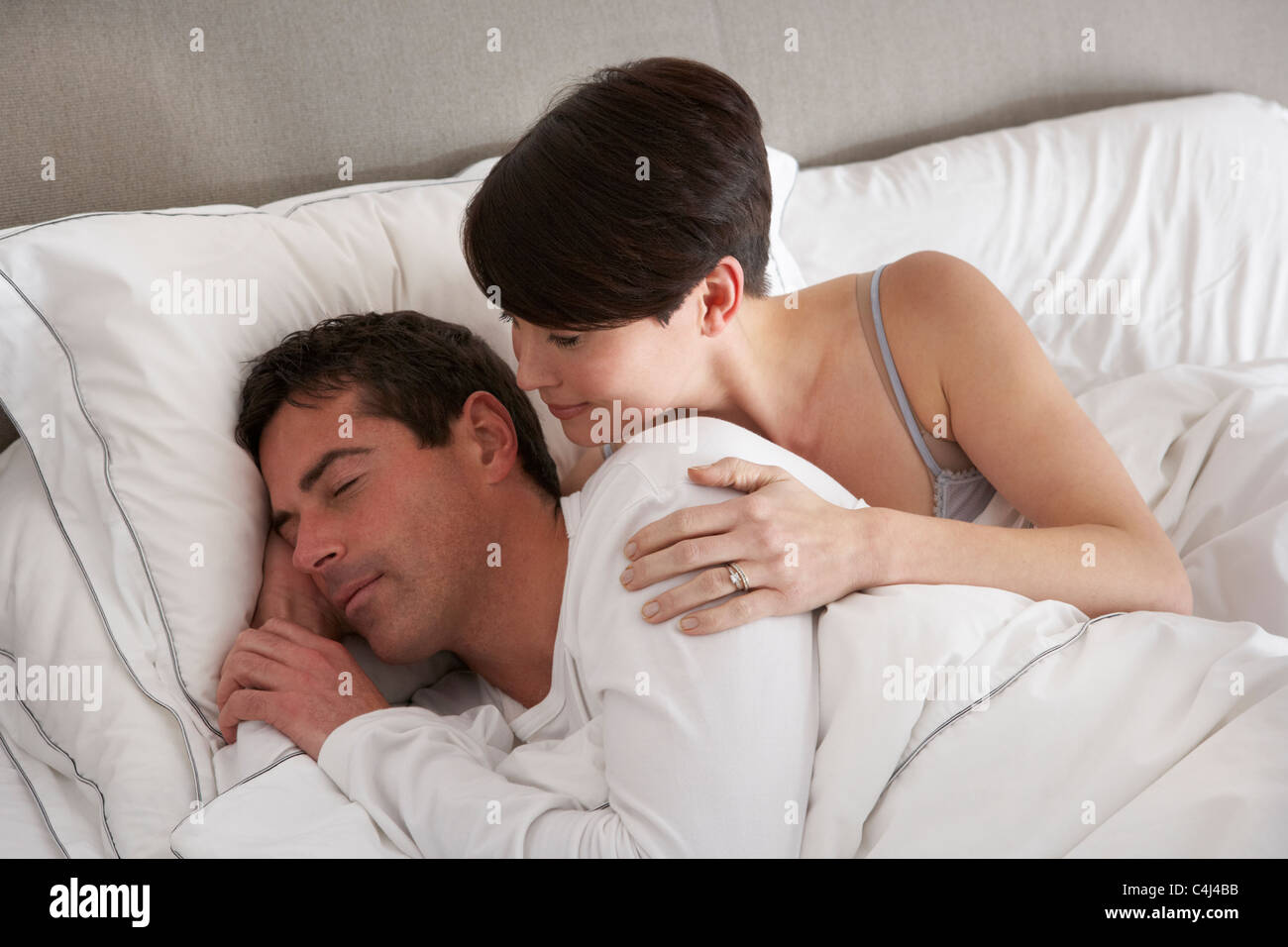 Couple With Problems Having Disagreement In Bed - Stock Image