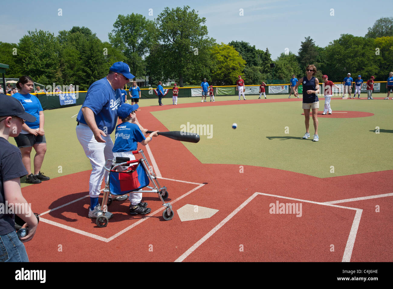 Children with Disabilities Play Baseball in the Miracle League - Stock Image