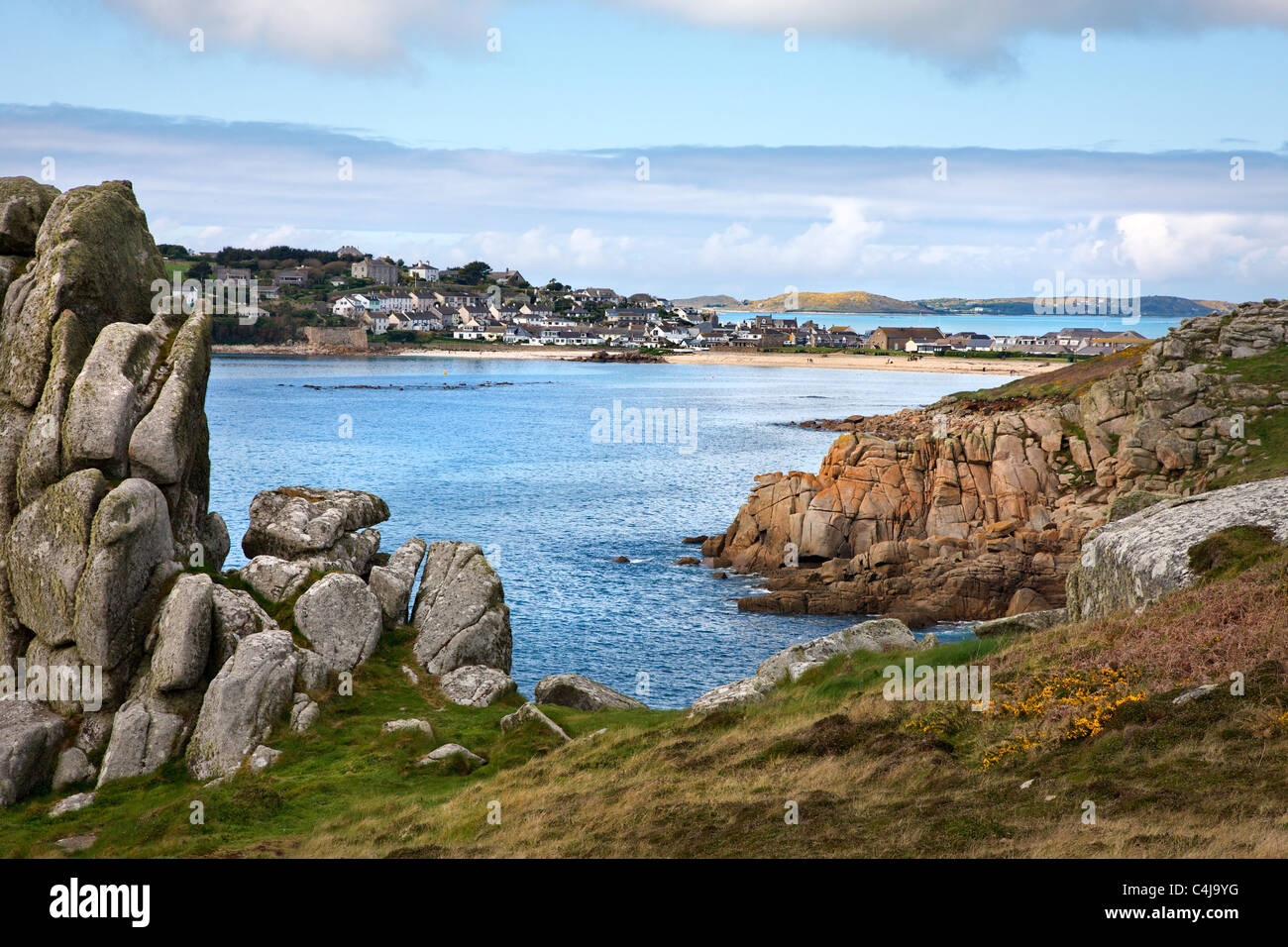 Hugh Town and Porthcressa beach on St Mary's Isles of Scilly with the island of Bryher beyond - Stock Image