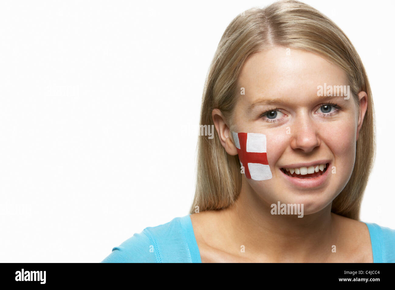 Young Female Sports Fan With St Georges Flag Painted On Face - Stock Image