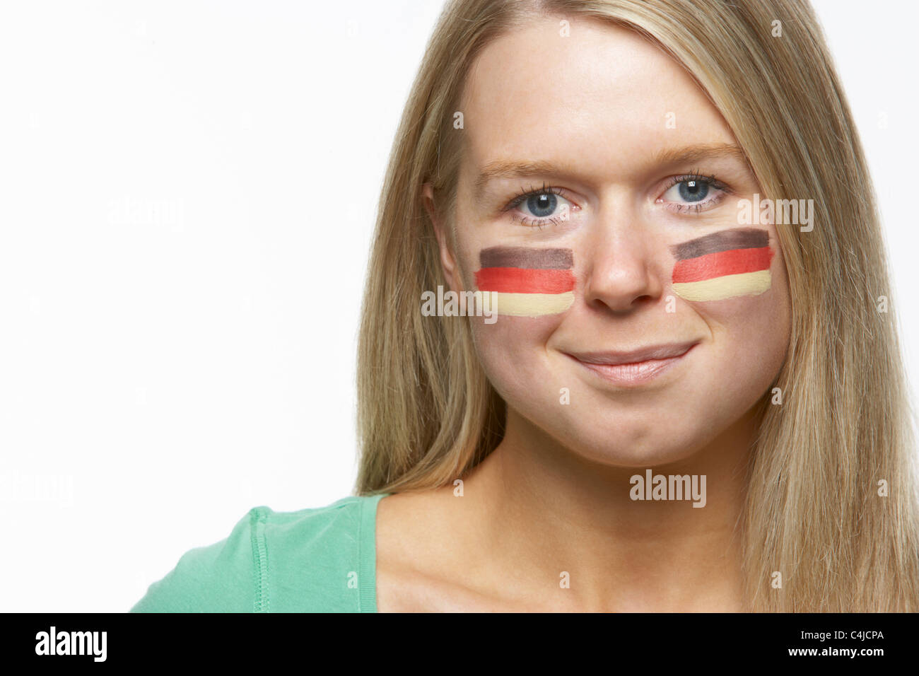 Young Female Sports Fan With German Flag Painted On Face - Stock Image