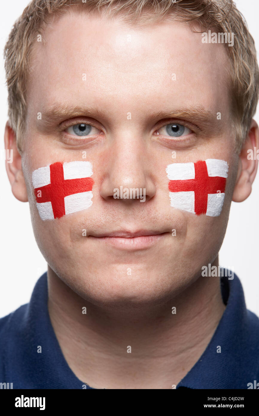 Young Male Sports Fan With St Georges Flag Painted On Face - Stock Image